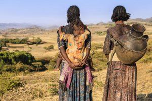 Women overlooking hill